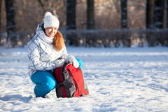 Young Caucasian woman with backpack in winter park Stock Photography