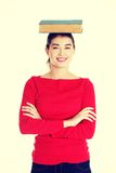 Young caucasian woman with book on her head Royalty Free Stock Image