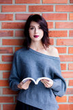 Young caucasian woman with book Royalty Free Stock Photography
