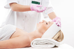 A young Caucasian woman on a botox procedure Stock Photo