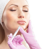 A young Caucasian woman on a botox procedure Royalty Free Stock Photos