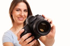 Young caucasian woman with camera Royalty Free Stock Photo