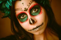 Young caucasian woman in catrina calavera style makeup horizontal portrait close up face royalty free stock photography