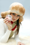Young caucasian woman with christmas toy Stock Photography