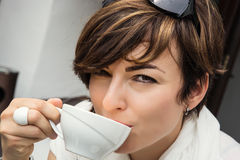 Young caucasian woman with coffee Royalty Free Stock Photos