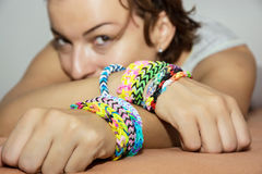 Young caucasian woman with colorful rubber bracelets on her hand Royalty Free Stock Images