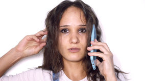 Young caucasian woman with curly hair talking mobile phone isolated on white background Stock Images