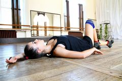 Young caucasian woman dancer on the floor Stock Photos