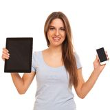 Young caucasian woman with devices Royalty Free Stock Photos