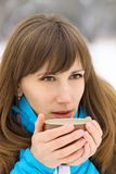 Young caucasian woman drinking hot coffee or tea Stock Photo