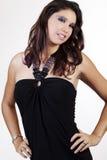 Young caucasian woman in elegant black dress Stock Images