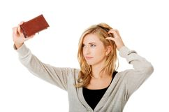 Young caucasian woman with empty wallet Royalty Free Stock Images