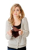 Young caucasian woman with empty wallet Royalty Free Stock Photo