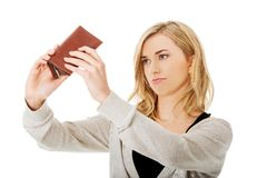 Young caucasian woman with empty wallet Royalty Free Stock Photos