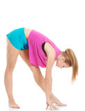 Young caucasian woman is exercising, bending down. Stock Image