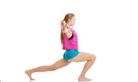 Young caucasian woman is exercising, stretching herself. Stock Photo