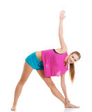 Young caucasian woman is exercising, stretching herself. Royalty Free Stock Image