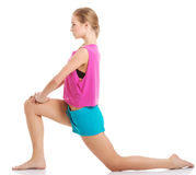 Young caucasian woman is exercising, stretching herself. Stock Images