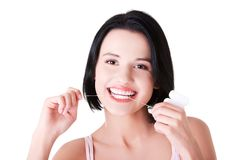 Young caucasian woman flossing her teeth Stock Photo