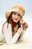 Young caucasian woman in fluffy hat Stock Photography