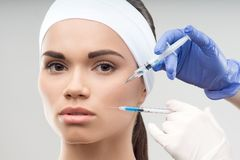 Young Caucasian woman getting cosmetic injection Stock Photography