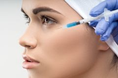 Young Caucasian woman getting cosmetic injection Stock Image