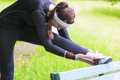 Young Caucasian Woman Having Stretching Exercises Outdors. Horizontal Image Orientation Stock Photography