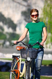 Young Caucasian woman with her bike Royalty Free Stock Photography