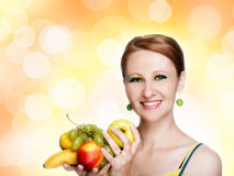 Young caucasian woman holding fruit Stock Image