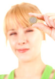 Young caucasian woman holding one euro coin Stock Images