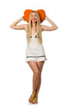The young caucasian woman holding orange cushion isolated on white Stock Photography