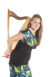 Young caucasian woman holds small harp in studio against white b Royalty Free Stock Images