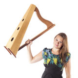 Young caucasian woman holds up small harp in studio against whit Stock Images