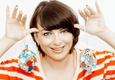 Young woman joking with easter eggs stock image