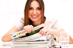 Young caucasian woman with journals Royalty Free Stock Photo