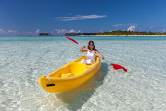 Young caucasian woman kayaking in sea Royalty Free Stock Image