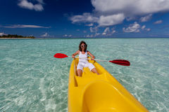 Young caucasian woman kayaking in sea at Maldives Royalty Free Stock Photos