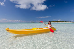 Young caucasian woman kayaking in sea at Maldives Stock Photography