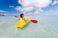 Young caucasian woman kayaking in sea at Maldives Royalty Free Stock Photo