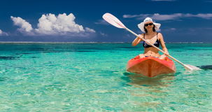 Young caucasian woman kayaking at tropical sea on yellow kayak stock video footage