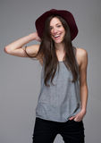Young caucasian woman laughing with red hat Stock Images