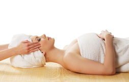 A young Caucasian woman laying on a spa procedure Royalty Free Stock Image