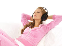 A young Caucasian woman listening to the music Royalty Free Stock Images