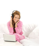 A young Caucasian woman listening to the music Stock Photography