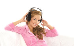 A young Caucasian woman listening to the music Stock Image