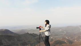 Travel photographer on field