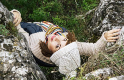 Young caucasian woman looking up in autumn nature, seasonal fash Stock Images