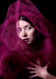 Young caucasian woman in magenta wrap. Stock Images