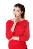 Young caucasian woman making silence sign Stock Photography