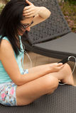 Young Caucasian Woman Messaging With Smartphone Royalty Free Stock Images